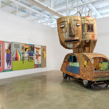 """Os Gêmeos, """"Within the Rainbow, That's How it is"""" (2010) and """"Untitled"""" (2008). """"Everything You Are I am Not: Latin American Contemporary Art from the Tiroche DeLeon Collection."""" MANA Glass Gallery, Jersey City. Courtesy: MANA Contemporary/Photo:  John Berens"""