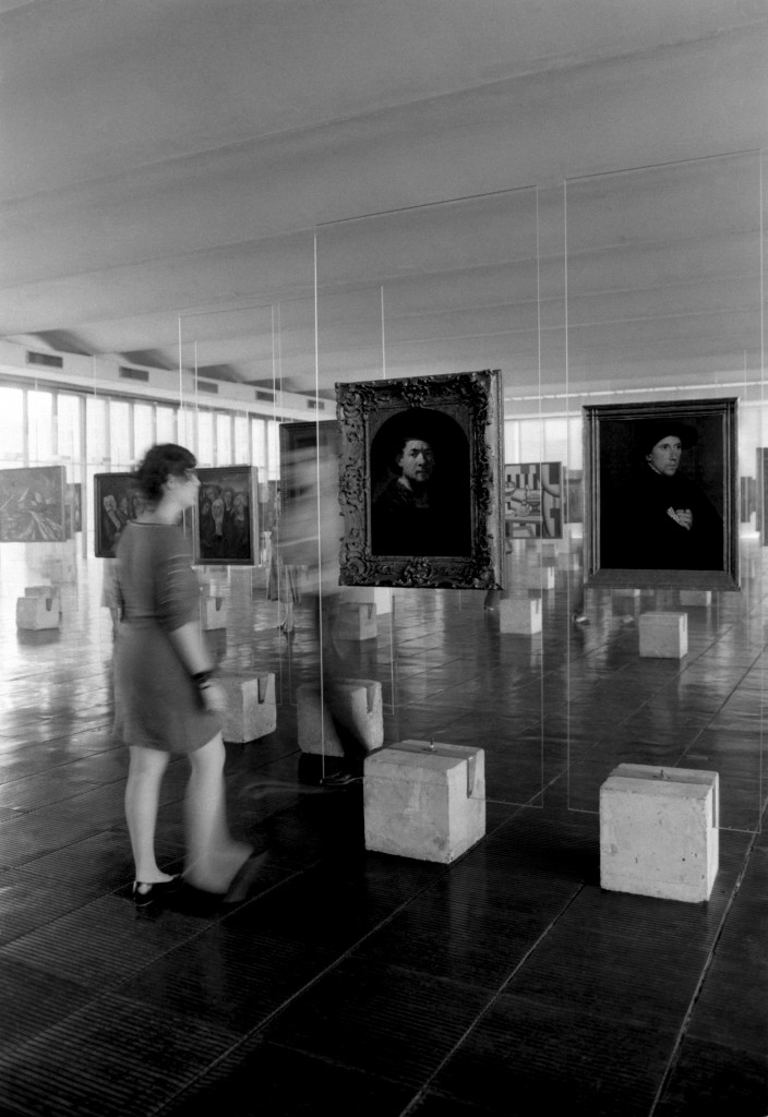 In 1968, a miniskirted visitor admires Rembrandt's self-portrait circa 1635 and a portrait by Holbein-The-Younger from 1542/Photo: MASP