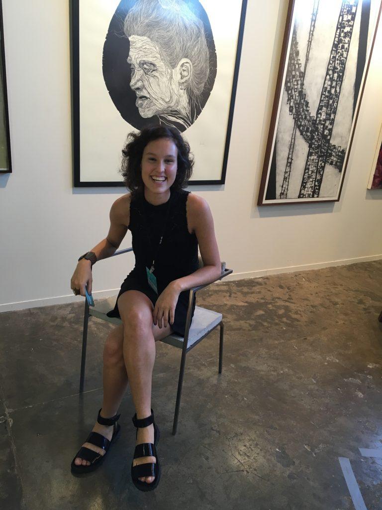 Student designer Sofia Venetucci sits in her concrete design