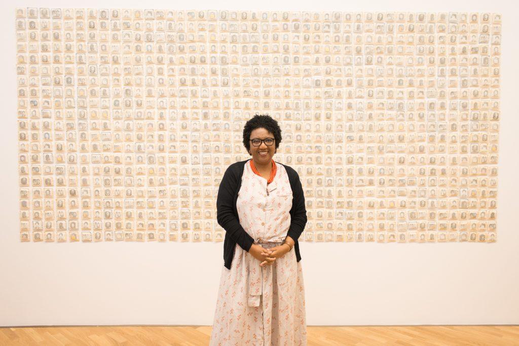 Rosana Paulino and her work Parede da Memória (Memory Wall), 1994-2015, at the artist's current retrospective in São Paulo's Pinacoteca.