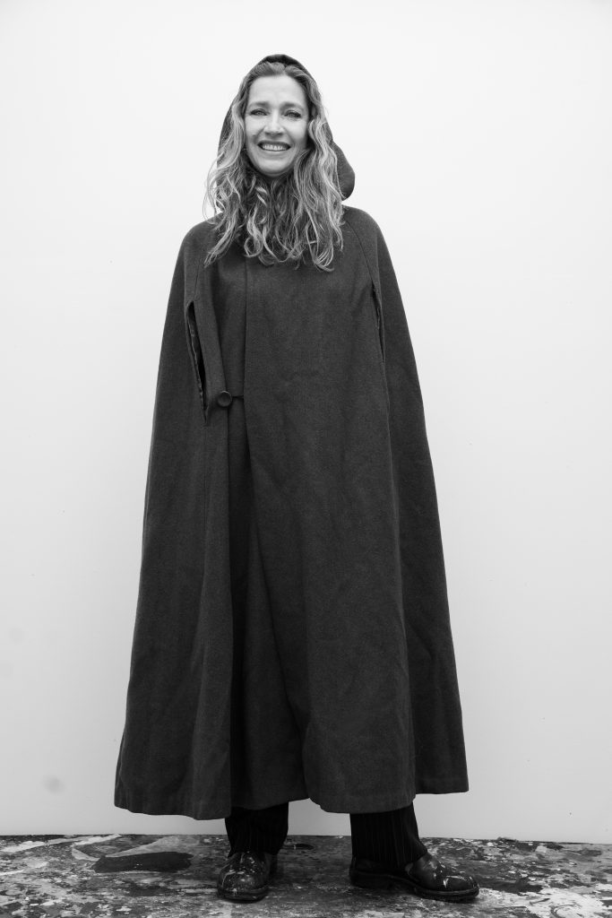 Janaina Tschäpe pictured wearing a hooded cape.