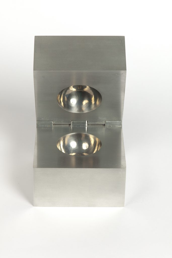 A steel box with a ball-shaped missing center.