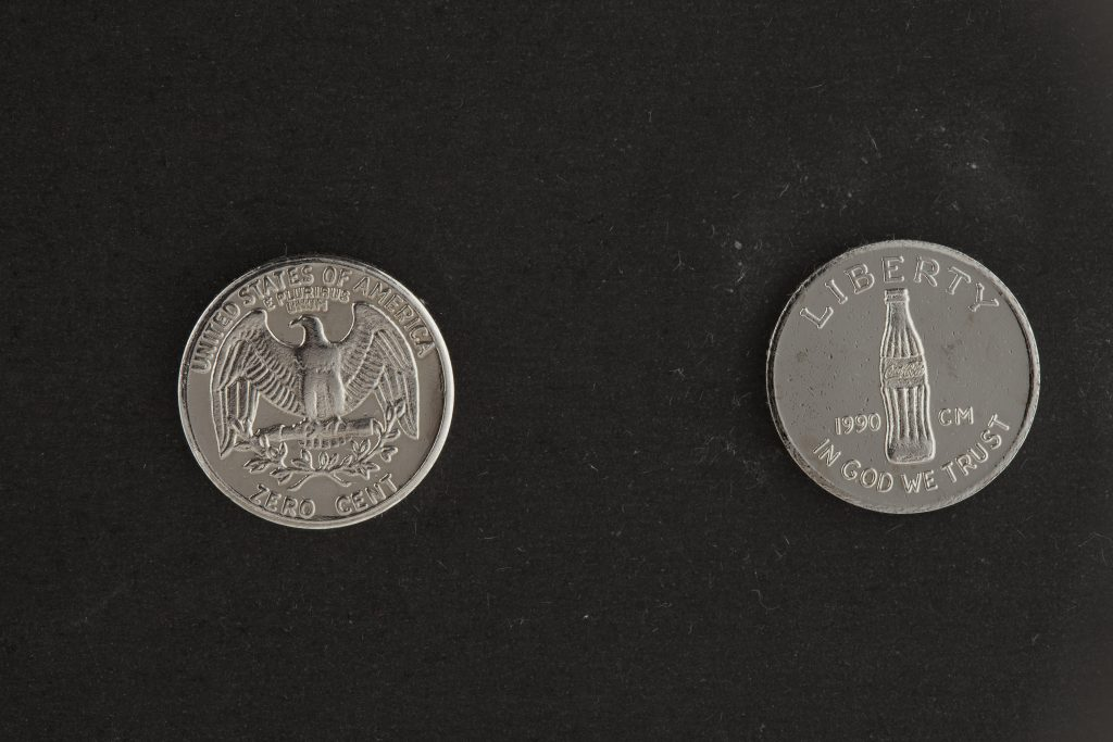Cildo Meireles-designed American quarter, with one side showing a Coke bottle instead of president.