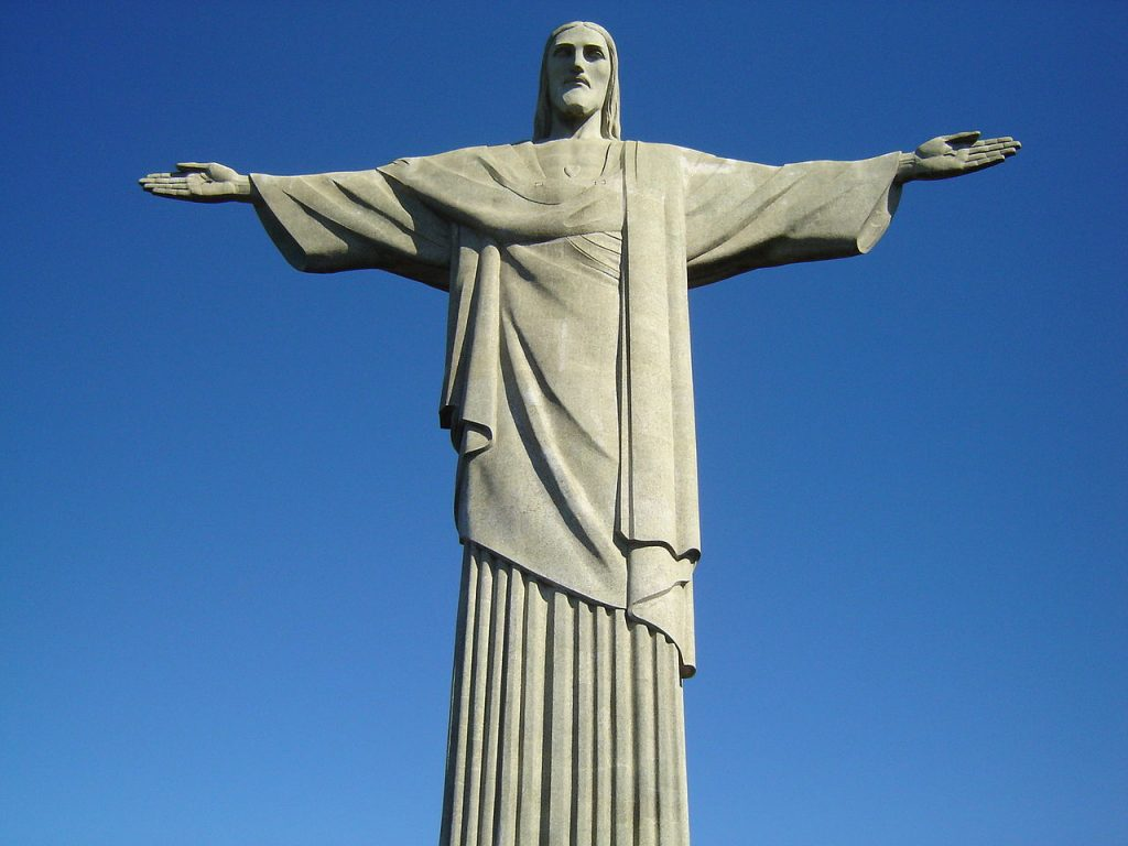 Christ the Redeemer statue in front of blue skies